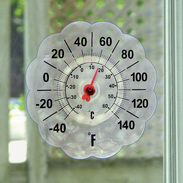 Suction Cup Window Thermometer, Clear Our pretty, scalloped suction cup window thermometer attaches to your window's exterior so you will always know the outdoor temperature. The bold, easy-to-read numbers show degrees in both Fahrenheit and Celsius, and the see-through vinyl won't block your view. This outdoor window thermometer measures 7 diameter.