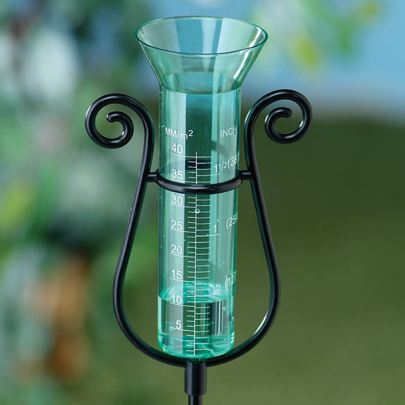 Graceful Garden Rain Gauge Green This graceful garden rain gauge is attractive and accurate. A useful garden aid, our rain gauge even measures lawn and garden watering volume. Sturdy acrylic body won't shatter; strong aluminum ground spike keeps gauge upright. Holds up to 1 1/2 of rain. 34 1/4 high x 5 1/4 wide.