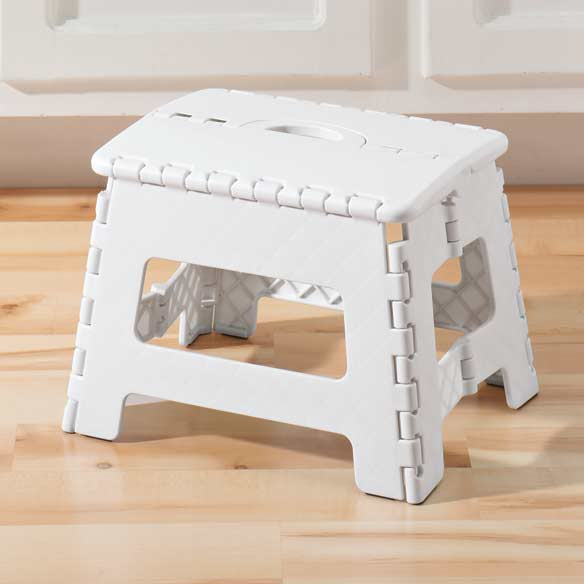 Folding Step Stool Folding for storage, then easily unfolding, this sturdy space-saver gives you a quick 9 boost when needed. Our folding step stool holds up to 300 lb., but folds to less than 2 wide for easy storage and transport. This durable plastic foldable step stool has a skid-resistant top and feet, plus carrying handle. 12 1/2 long x 10 1/4 wide x 9 high. Made in the USA.
