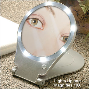 Lighted Home and Travel 10x Mirror Get up close for a flawless appearance!Tweeze eyebrows perfectly, apply makeup precisely, remove facial hair. Lighted mirror provides 10X magnification to see exactly what you're doing. Bright bulbs never need replacing. Cover flips over to create a stand for hands-free use. Folds to 1  flat for travel and storage. Measures 7 x 9 1/4 ; 6  dia. view. Uses 3 AAA batteries, included.