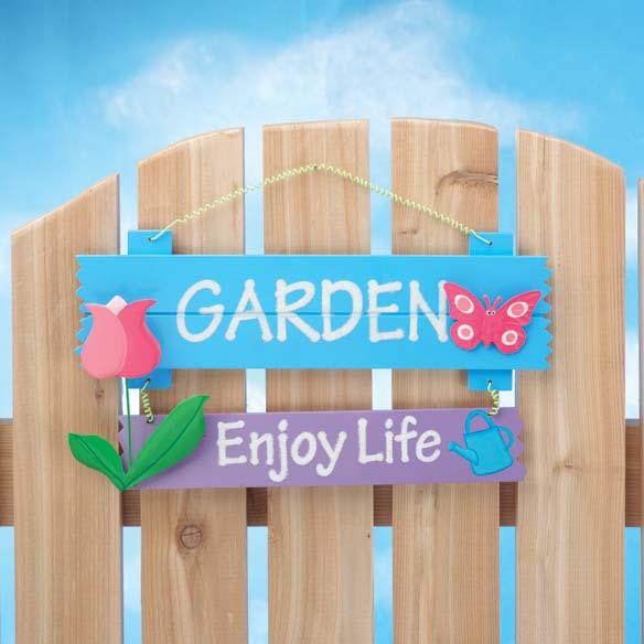 Enjoy Life Garden Sign A bright reminder to  Garden  and  Enjoy Life , our sign adds simple charm to any setting. Adorned with colorful, 3-D tulip and butterfly; for indoor/protected outdoor use. Fiberboard, metal. 11 1/4  long x 7 1/4  high.