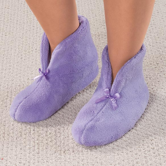Chenille Slippers Small Plush chenille slippersonalized keep feet warm and cozy. Feature non-skid soles, easy on/off design and seamless interior. Small fits women's shoe sizes 5–6; Medium fits 7–8; Large fits 9–10; XL fits 11–12. Machine-washable polar fleece upper/lining.