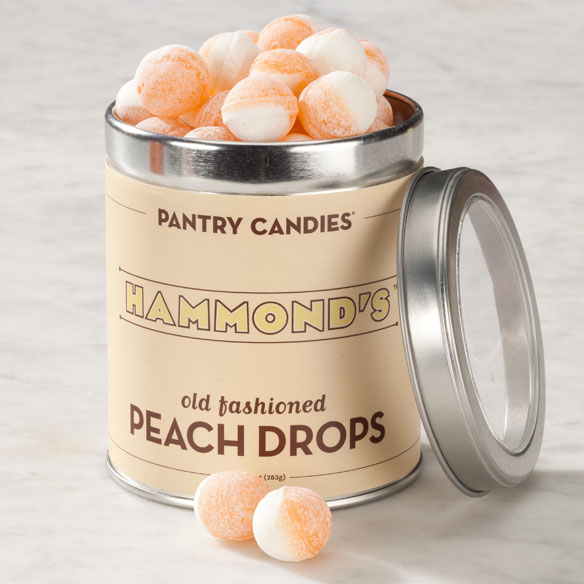 Hammond's Old Fashioned Peach Drops - 10 oz. Decades ago, Hammond's hard candy was made slowly and in small batches-as these nostalgic peach drops still are. Smooth and comforting, they deliver the perfect peach flavor that's light with just a kiss of sweetness, lasting all the way through. Beautiful in the candy dish, the generous size drops are swirled in peach and cream, sanded with a bit of sugar are sure to make you smile. Packed in a nostalgic tin for a fun, little hostess gift, each sweet, satisfying treat lasts a good long time. 10 oz.|||Ingredients |||Nutrition Info