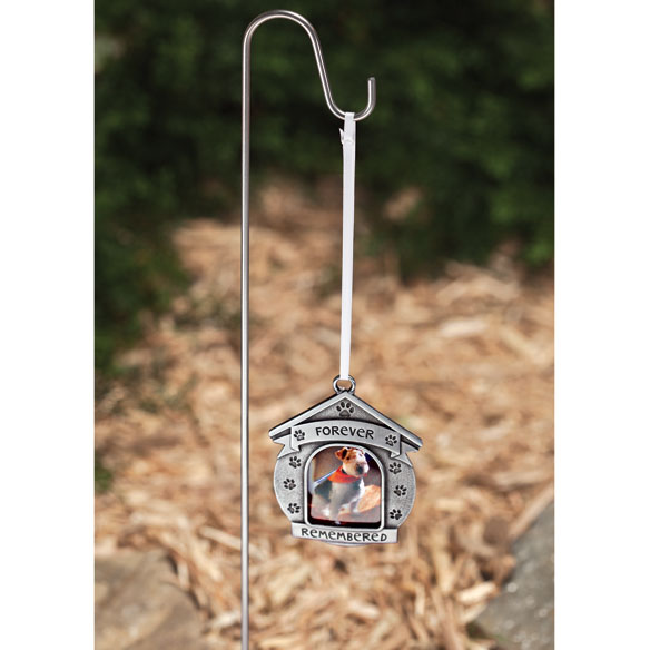Forever Remembered Garden Stake Keeping your loving pet's memory close, this beautiful Forever Remembered garden stake is adorned with paw prints-like the ones etched forever on your heart. Simply add a special photo to this pet memorial for loving display in a potted plant or protected outdoor area. Set includes 2 3/4 long x 2 1/2 wide silvertone metal frame with 1 1/2 dia. photo opening and 18 high metal stake. This memorial garden stake makes a thoughtful, comforting gift!