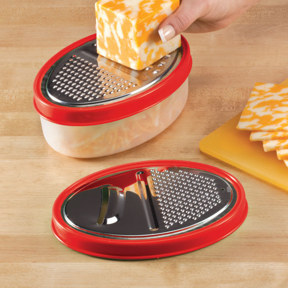 Oval Grater by Home-Style Kitchen With two snap-on grating lids and one  catching bowl , this versatile oval grater by Home-Style Kitchen lets you grate without the plate ... or the mess. As you shred, grate or slice cheese, onions, carrots, citrus, chocolate and more, the shavings fall neatly into the food grater bowl, making kitchen prep quick and easy. Red lids offer four stainless steel grating options; 6 3/4 long x 4 1/2 wide plastic bowl holds 2 to 3 cups. Hand grater is dishwasher safe.