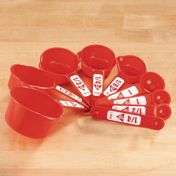 9-Pc. Measuring Cup Set by Home-Style Kitchen The large, easy-to-see markings on this 9-pc. measuring set by Home-Style Kitchen lets you measure ingredients simply and precisely! Printed in white for readable contrast on red, each measuring cup lists standard and ml measure markings. Plastic measuring cups feature spouts for easy pouring; a plastic ring keeps all 9 pieces nested for storage, yet easily detachable for using and washing. Set includes 5 cups (1-cup, 1/2-cup, 1/3-cup 1/4-cup, 1/8 cup) and 4 spoons (1-Tbs., 1-tsp., 1/2-tsp. and 1/4 tsp). Plastic; hand wash.
