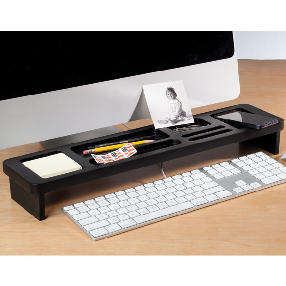Desktop Storage Shelf Instantly organizing any desktop, this desktop storage shelf's seven compartments hold pens, pencils, sticky notes, paper clips--and best of all, your coffee cup. Keeping essentials contained and conveniently in reach, the raised wooden storage shelf even allows space to slide your keyboard underneath for the ultimate in tidy! Great for home office or kitchen counter, the desktop shelf also adds a touch of style in classic black fiberboard. 21  long x 5 1/8  wide x 2 3/4  high.