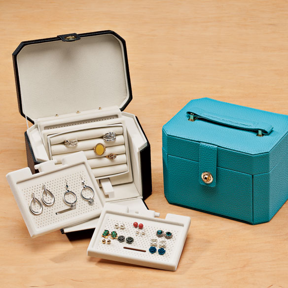 Jewelry Chalet Vanity Portable jewelry chalet vanity makes it easy to accessorize on the go. Soft felt interior protects valuables while the hard outer casing prevents damage when traveling. Convenient mesh trays securely hold and release pierced, clip-on and hoop earrings. 3 earring trays, 1 ring tray and 1 necklace tray measuring 5 1/2  L x 4 1/4  W each. Includes 20 hooks to hold hoop-style earrings. Specify color: black or turquoise. 7 3/4  L x 5 3/4  W x 5 1/4  H overall. Plastic, felt, metal.