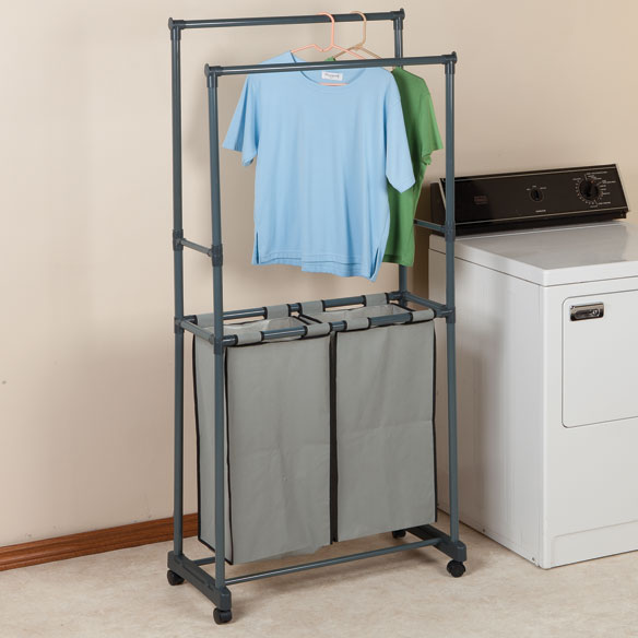 Clothing Rack with Hampers Enjoy easier laundry days with this all-in-one clothing rack with hampersonalized. Double laundry hampersonalized make separating simple. Hanging rods at 2 heights provide plenty of space for air drying. Wheels save you from heavy lifting as you roll from bedroom to laundry room. Also great for adding additional hanging space in a closet. Sturdy steel clothing rack with canvas hampersonalized wipes clean and can be taken apart for easy storage when not in use. 29  L x 15 1/4  W x 67  H. Hampersonalized each measure 12 1/2  L x 10  W x 24 1/2  H.
