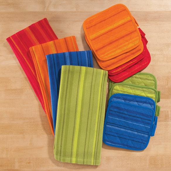 Striped 3 Piece Kitchen Towel Set this striped 3 piece kitchen towel set complements your kitchen with cheerful stripes. Generously sized, cotton waffle-weave hand towel quickly dries dishes, hands and countertops. Two coordinating pot holders protect hands from heat and double as hot pads on your serving table. All 3 pieces feature loops for hanging. Choose from 4 striped colors to complement any decor: red, blue, green or orange. 100% cotton towel measures 18 1/2  x 26 1/2 . Pot holders are 6 3/4  sq. Machine wash.