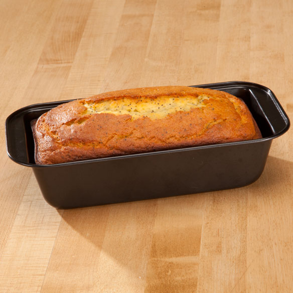 Toaster Oven Bread Pan by Home-Style Kitchen Bake something quick and delicious in a compact toaster oven bread pan designed just for smaller baking appliances. Durable non-stick carbon steel bread pan distributes heat evenly--offering homemade goodness and golden brown perfection. 10  L x 5  W x 2 1/2  H. Dishwasher safe.