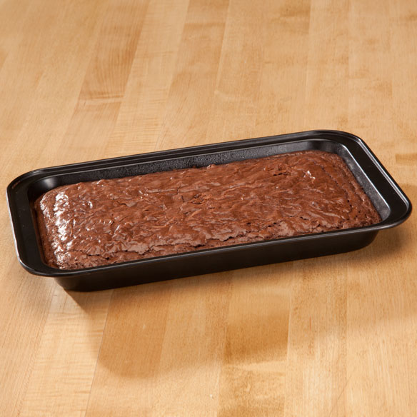 Toaster Oven Brownie Pan by Home-Style Kitchen Bake something quick and delicious in a compact toaster oven brownie pan designed just for smaller baking appliances. Durable non-stick carbon steel brownie pan distributes heat evenly--offering homemade goodness and golden brown perfection. 11  L x 7  W. Dishwasher safe.