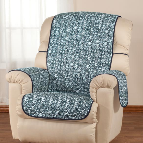 Reversible Fashion Chair Cover by OakRidge Comforts This 1-pc. reversible fashion chair cover by OakRidge ComfortsTM offers chair protection that's blooming with style! Furniture cover protects against spills and stains as it adds a designer look to any room. With fabric ties that wrap around the back and top to secure it in place, it's ideal for small recliners and wing chairs. Comfortable, quilted polyester seat cover is machine washable for easy-care convenience. Reversible design is midnight floral on one side, solid midnight blue on the other, for two great looks in one! 60  L x 19  W.