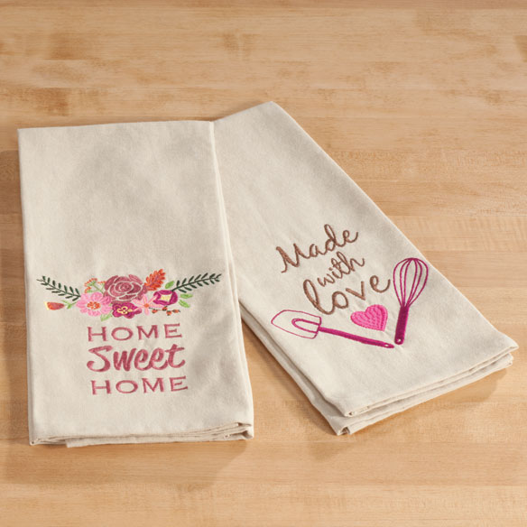 Embroidered Cotton Kitchen Towel Bright artist's designs adorn these 100% embroidered cotton kitchen towels--making them worthy of display and perfect for giving! Fun for hostess gifts, wedding showers or your own pretty kitchen, each soft, absorbent cotton towel is thoughtfully finished with a hanging loop. Machine wash. Dish towel measures 18  x 28 . Imported.