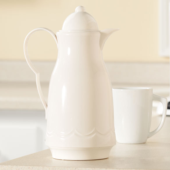 White Coffee Carafe Offering style, durability and energy-saving convenience, this classic white coffee carafe with triple-wall polyurethane insulation keeps coffee hot longer. For neat, easy serving, simply press the thumb lever down to pour and release to seal. The 40-oz. insulated carafe is made of impact-resistant resin with odorless, stain-proof insulated liner and comfortable, easy-grip handle. Thermal carafe is dishwasher safe.