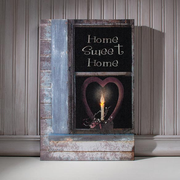 Lighted Home Sweet Home Canvas Inspiring sweet memories of hearth and home, this lighted Home Sweet Home canvas adds warmth to any decor. The gallery-wrapped lighted canvas features a single flickering LED light for the candle's flame, offering a stunningly realistic look. Requires no frame or cords, and its side on/off switch lets you activate the lights without removing it from the wall. The wood frame stretched canvas print is 3/4  thick and includes two sawtooth hooks for hanging. Uses 2 AA batteries (not included). 17  wide x 11  high.