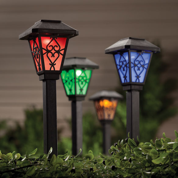Color Changing Solar Lights S/3 Constantly changing its glow from red to green, blue and purple, this color changing solar light set collects sunlight, automatically activating at night. Stake several outdoor solar lights in your yard for a rainbow of color--lighting walkway, flower bed and more. Features on/off switch; includes rechargeable battery. Plastic. 3  wide x 10  high; 3/4  sq. stake. Set of 3.