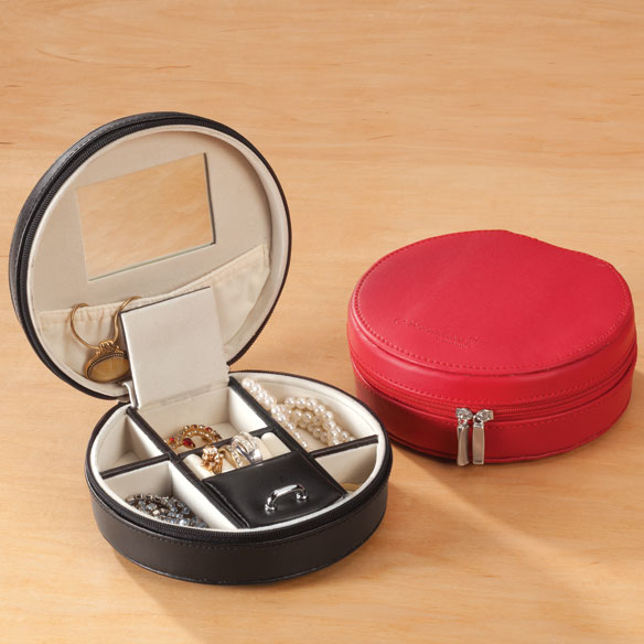 Round Travel Jewelry Case Get around in style with this round travel jewelry case! Available in red or black to complement any luggage, the leather exterior unzips almost all the way around. Well-thought-out interior features 2 covered and 4 open compartments, 4 ring slots, elasticized pouch and mirror for accessorizing on the go. At 5 1/2  dia. x 2  H, this round jewelry travel case is sized just right for stashing in your tote or carry-on bag