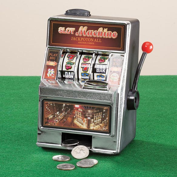 Small Slot Machine with Lights and Bank Bring the excitement of a Las Vegas casino to your own home, office or Dorm! This Lucky Las Vegas Casino MINI Slot Machine Toy is an actual working slot machine bank with pay out ability. Wide spinning wheels with chrome bevel and tray give a professional, seamless look. Accepts 98% of world coins, manual and jackpot coin returns. 4  long x 5 1/2  wide x 7 1/4  high.