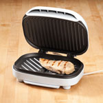 Panini Contact Grill Enjoy low-fat grilling and easy cleanup from the comfort of your kitchen--saving you time and hassle when cooking for one or two! The 600W Panini Contact Grill from Brentwood Appliances makes indoor, low-fat grilling quick, easy and delicious. Compact size adds authentic sear marks to whatever you cook inside. With non-stick coating and dishwasher-safe drip tray to catch fat and oil, you'll enjoy hot griddled sandwiches or grilled meats, using less fat or butter. On rare occasions when not in use, this electric grill stands upright for compact storage. 9  L x 8  W x 2  H.