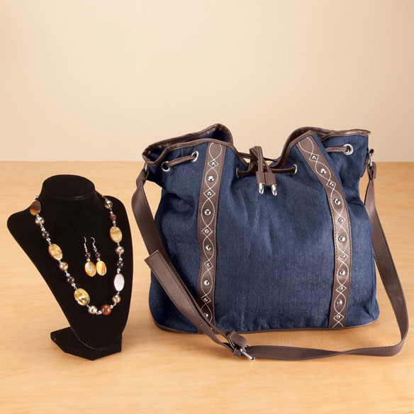 Handbag and Jewelry Set Freshen your wardrobe with this fashionable handbag and jewelry set. Handbag in dark denim adds smart style with its chocolate faux leather trim and silver accents. Magnetic snap with faux leather drawstring is a cinch to open, where you'll find a roomy interior compartment with 2 pockets, 1 with a zipper. Accessorizing is easier than ever with the perfectly coordinated necklace and earring set. Bold, beautiful necklace makes a style statement with genuine obsidian, mother of pearl and crystals. Matching drop-style earrings dangle eye-catching mother of pearl and obsidian from French wires. Necklace with lobster clasp measures 19  L with included 3  extender; earrings drop 3 . Denim bag measures 13  L x 6 1/2  W x 13  H with a 32 -35  L adjustable strap. Shell is 65% cotton/35% polyester with poly lining; hand wash cold, line dry.