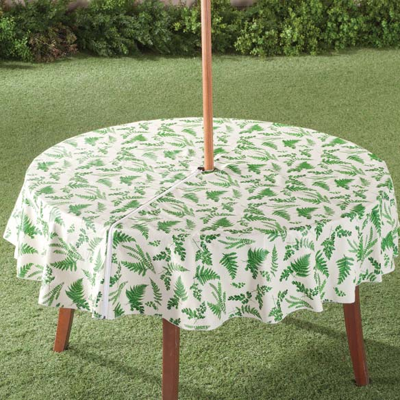 Garden Greenery Zippered Umbrella Table Cover With its rich greenery against a sand background, this Garden Greenery zippered umbrella table cover puts a fresh take on outdoor living. Table cover's conveniently placed zipper makes it easy to put on and remove and leaves the center open to accommodate a sun umbrella. Easy-care vinyl table cover is ideal for outdoor dining and wipes clean in seconds. Soft flannel backing protects table surfaces from scratches. Imported.