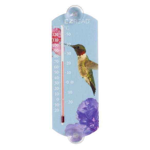 Hummingbird Window Thermometer Unlike the other pretty hummers that grace your window occasionally, this one will stay ...offering accurate temperature updates at a glance. Graced with a high definition photograph of a beautiful hummingbird, this indoor/outdoor thermometer features easy-to-read markings, indicating accurate temperature readings in both Fahrenheit and Celscius degrees. Includes a suction cup for easy mounting to window. Plastic, glass.. 10  H.