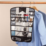 The Butler Organizer Keeping his accessories neatly contained yet clearly in sight, The ButlerTM organizer is an organized man's best friend! Hanging conveniently in closet or garment bag on a metal swivel-hook hanger, this closet organizer allows at-a-glance access to cuff links, rings, watches, keys and more. The space-saving organizer features 20 see-through pockets, 2 mesh pockets, 6 metal hanging bars for belts, buckles, ties, 3 elastic loops for eyeglasses and 3 metal hooks for jewelry. Polyethylene, stainless steel. Wardrobe organizer measures 16 3/4  W x 21 1/2  H.