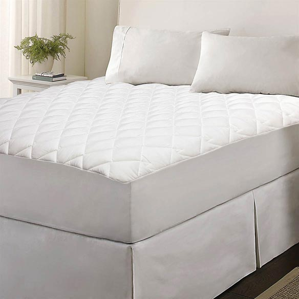 Kathy Ireland Home Essentials Microfiber Mattress Pad Kathy Ireland Home Essentials Microfiber Mattress Pad with 14  stretchable polyester skirt fits mattresses 15 -18  thick. Diamond pattern sewn-through quilt stitching. 100% Microfiber top fabric. Polyester fiber fill. Machine washable.