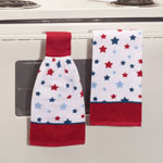 American Stars Kitchen Towel Set Boasting patriotic style in 100% cotton, these American Stars kitchen towels are beautiful, practical, and wonderfully affordable! With an all-over star and bold red borders, they'll charm your American kitchen on patriotic holidays or any day. Hand towel set includes one tie towel and one standard kitchen towel. Machine wash. Set of 2. Tie towel: 8 1/2  x 17 . Standard towel: 16  x 26 .