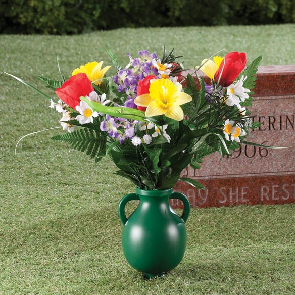 Garden Cemetery Vase This classic garden cemetery vase stakes securely in the ground--making it easy to create a beautiful memorial arrangement at the cemetery, or right in your own garden. Simply fill the garden vase with seasonal flowers or greenery (not included) and anchor its attached spiral stake securely into softened ground for quick, stable placement. Memorial vase constructed of durable, molded plastic. 10  L x 5  W x 6 1/2  H vase; 3 1/2  L stake.
