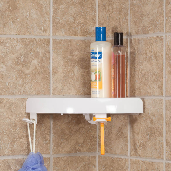 Self Adhesive Corner Shelf Self-adhesive corner shelf turns unused corner space into valuable storage space! Simply place in a corner and flip the lever. Non-slip polymer pads on the sides grip onto tile, drywall, marble, glass and more with no tools required. Durable plastic corner wall shelf features drainage holes, 2 storage holes and 2 adjustable hanging hooks. Perfect for shower stalls and bathrooms, garages, laundry rooms and more. Add 2 or more for multi-tier convenience! Corner shelf unit supports up to 10 lbs. and detaches just as easily without damaging walls. 9  long x 9  wide x 1 3/4  high.