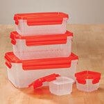 Nested Food Containers 10 pc Featuring airtight lids that attach and detach with handy pull tabs, these nested food containers stack efficiently in fridge, freezer or pantry--then nest neatly for space-saving storage. A smart solution for organized food storage and transport, the clear, reusable storage containers are designed in durable BPA-free plastic and safe for microwave and dishwasher. Set of 10 kitchen containers includes: two 3-oz. containers with lids (2 1/2  x 2 1/2  x 1 3/4  H), one 13.5 oz. container with lid (6  L x 3 1/2  W x 2 1/4  H), one 27-oz. container with lid (7  L x 4 1/2  W x 2 1/2  H) and one 54-oz. container with lid (8 1/4  L x 5 1/2  W x 3 1/16  H).
