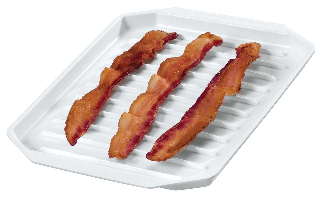 Microwave Bacon Platter, White Crispy bacon from the microwave? Yes-every time! This microwave bacon platter features raised ridges so grease drains off and elevates strips for a crisp, crunchy taste. Bacon tray makes less mess than cooking on the stovetop. Cooks sausages, hot dogs, brats, too! Plastic; dishwasher safe. 9 3/4 long x 8 wide x 7/8 high.