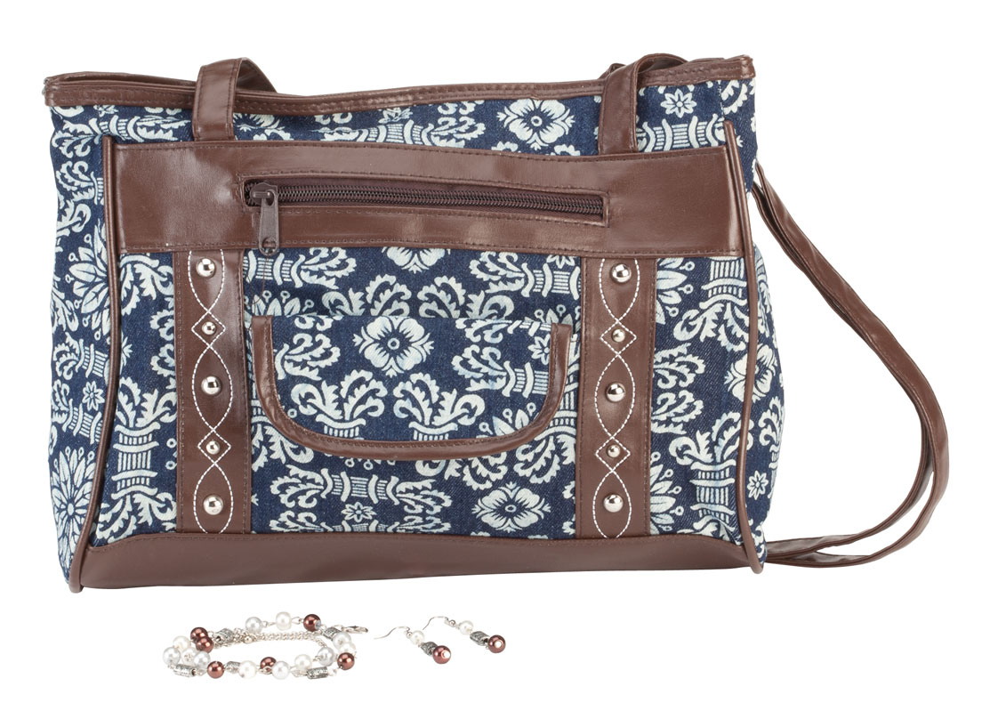Printed Handbag and Jewelry Set Add bold style to your wardrobe with this print handbag and jewelry set. Perfect for any season, the canvas handbag features a fun, fashionable print with brown faux leather trim and silver accents. A snap-close pocket and zip compartment on the exterior provide easy access to essentials, while the zip-close interior features a smaller zip pocket. Accessorizing is easier than ever with the coordinating necklace and drop-style earrings, featuring beads in rich browns, silvertone and pearly hues. Necklace with lobster clasp measures 21  L with included 2  extender. French wire earrings drop 2 . Canvas/PVC women's handbag with 15  drop handles measures 12  L x 4  W x 8  H. Wipe with damp cloth.